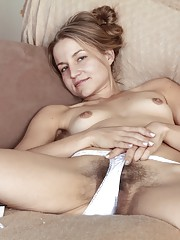 Hairy chick Rachel plays with bush before bed