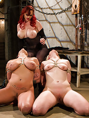 Mz Berlin dominates two large breasted submissive lesbian sluts!