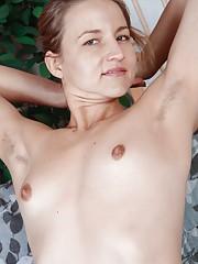 Rachel Shows off cute hairy mound on futon