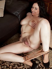 Hairy Sophia Delane gives strip tease