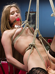 Lesbian lounge singer gives thieving waitress a lesson in bondage, pussy licking, strap-on fucking and pain.
