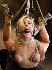 Cherie Deville is made to choke herself to get off, endures a back breaking hogtie, vicious lunge predicament, & intense inverted suspension.