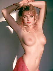 Erika Eleniak is sitting in the living room of her mother