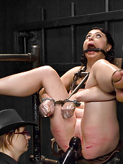 American Sioux Indian Siouxsie Q gets mercilessly tormented in latex, harsh chain bondage, fucked in the ass through a speculum & caned hard!