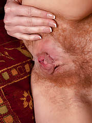 Sexy cougar Ashleigh Mckenzie spreads her moist hairy pussy