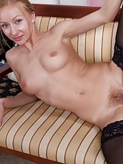 Hairy girl Lisa T stretches her long legs