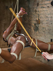 Amazing Ana submits to very strict and challenging bondage including inverted spread eagle suspension, ball tie strappado, and strict straddle spread!
