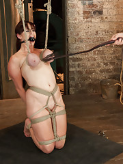Bella returns to endure a cat 5 breast suspension with no assist ropes, inverted suspension, crucifixion, aggressive fucking, and a day with the cane!