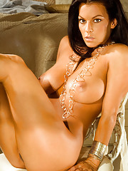 Nancy Erminia will cast you under her sexy spell wearing only silver jewelry and a sultry smile.�
