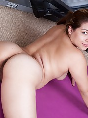 Hairy girl Daisy Leon works out her hairy pussy