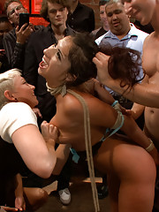 Flirtatious young vixen bound and fucked in a crowded bar