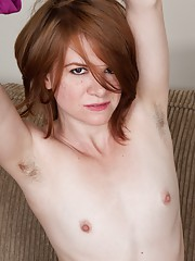 American redhead Zia strips and shows fire