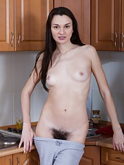 Eliza loves her hairy pussy in the kitchen
