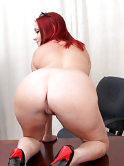 Hot secretary gets naughty in the office and fingers her wet pussy
