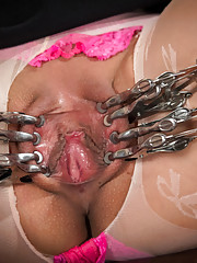 Vivi Marie proves her devotion to pain as Mz. Berlin single tails, shocks, clamps, and doubly penetrates Vivi
