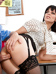 The sexy Bobbi Starr bends over in sexy fishnet stockings and prepares to be fucked from behind by her co-worker.