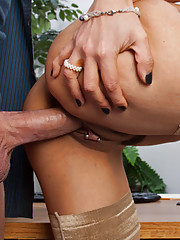 Hot brunette girl sucks dick and rides it to pass the time at work.