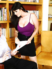 Sophie Dee has hot sex with younger guy at the office.