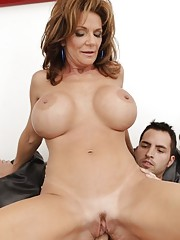 Busty cougar Deauxma seduces younger guy and makes him fuck her pussy and ass.