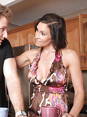 Brunette MILF gets fucked in the kitchen.