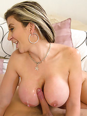 Busty blonde MILF Sara Jay fucks younger cock and rides it on the bed.