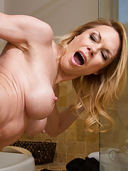 Busty blonde MILF Lexa Style fucks younger cock after sneaking up on him in the bath.