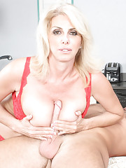 Penny Porsche is  a hot and busty MILF who is ready to fuck a younger cock so she seduces one in her own house.