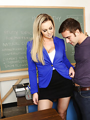 Gorgeous blonde teacher Abbey Brooks decides to fuck her student in her classroom.