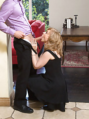 Busty Nina Hartley decides to fuck younger guy while she is alone with him.