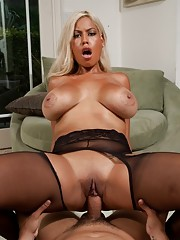 Busty blonde housewife Bridgette satisfies her husbands thick cock.