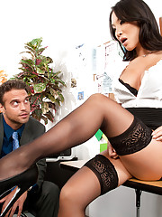 Asa Akira gets down on here knees and takes her co-workers cock in her mouth.