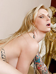 Tattooed blond demonstrates taking a hard cock pounding.