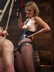 Divine Bitches announces the on screen debut of real life dominatrix Mona Wales. A true sadist, Mona revels in the pain she inflicts on her bitch boy.