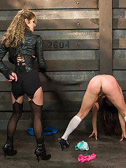 Local submissive fulfills her fantasy about a intense and real lesbian BDSM experience at the Armory and receives NO MERCY!