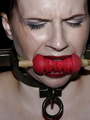 Latex clad Claire Adams rides wooden horse in bondage