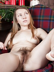 Stella strips naked by the Christmas tree to play