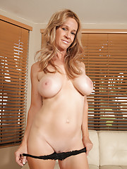 Gorgeous milf squeezes her big juicy tits and plays with her moist pussy