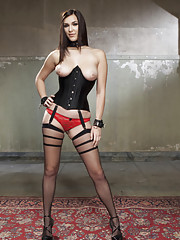 Holly Michaels in tight corset and heels disciplined in slave positions, face fucked, tits bouncing, fucked in the ass, pussy pounded by giant cock